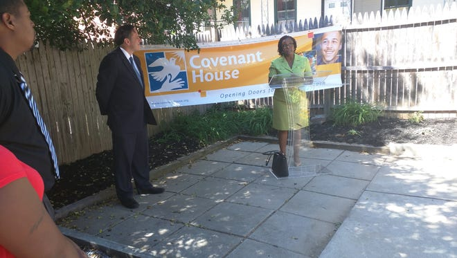 York City Mayor Kim Bracey, right, and Covenant House of Pennsylvania executive director John Ducoff speak at the opening of a center for homeless youth in York City.
