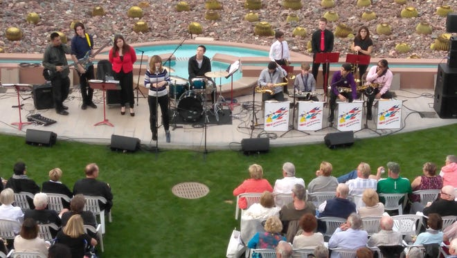 Patti Park, Executive Director of Angel View, introduces Heatwave Jazz and Show Band.