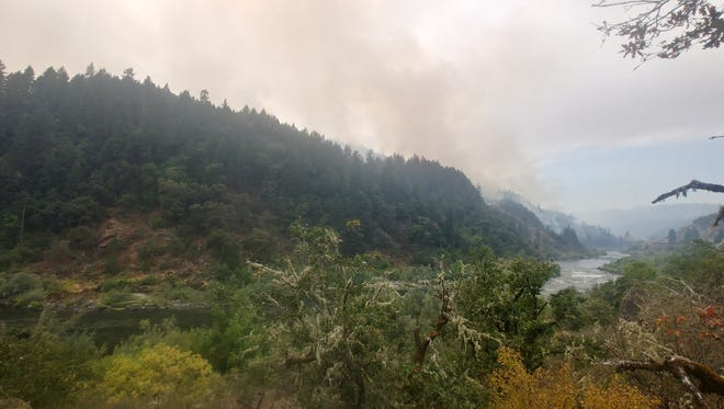 Views of the Taylor Creek Fire burning above the Rogue River west of Grants Pass on July 31, 2018.