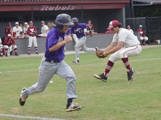 ASH's Suede Taylor (1, right) beats the throw to first