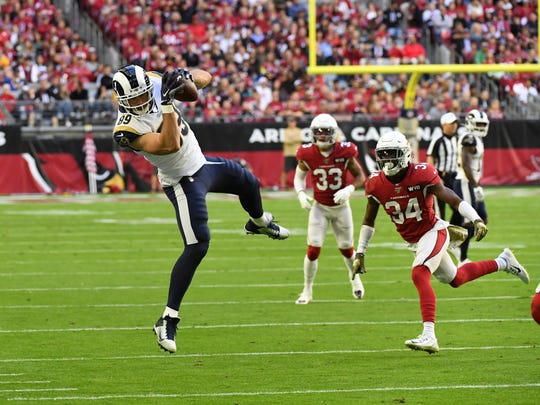 GLENDALE, ARIZONA - DECEMBER 01: Tyler Higbee #89 of the Los Angeles Rams makes a leaping catch against the Arizona Cardinals during the second quarter at State Farm Stadium on December 01, 2019 in Glendale, Arizona. Rams won 34-7. (Photo by Norm Hall/Getty Images)