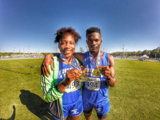 Godby sophomore Dorian Solomon won a state title in shot put, while senior Malik Honeycutt took gold in the triple jump during Friday's FHSAA Class 1A/2A track meet in Jacksonville.