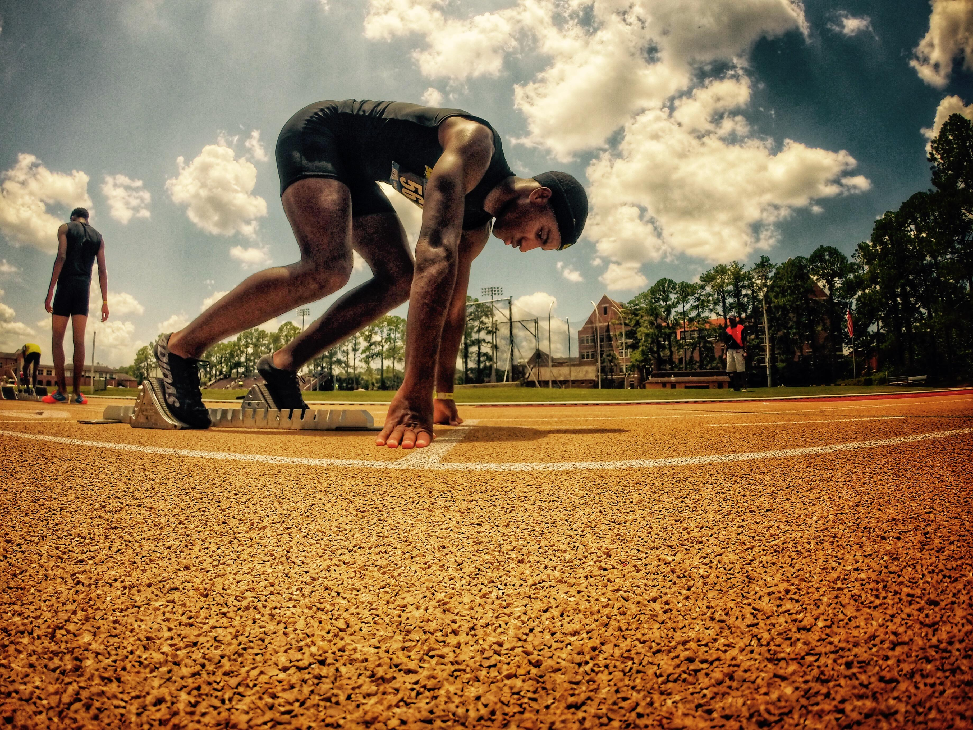 Michael Poole, a recent Lincoln grad and Florida A&M signee, prepares to burst out of the blocks during the Ernie Sims Track & Field Invitational. Poole is the son of North Florida Speed coach Corey Poole.