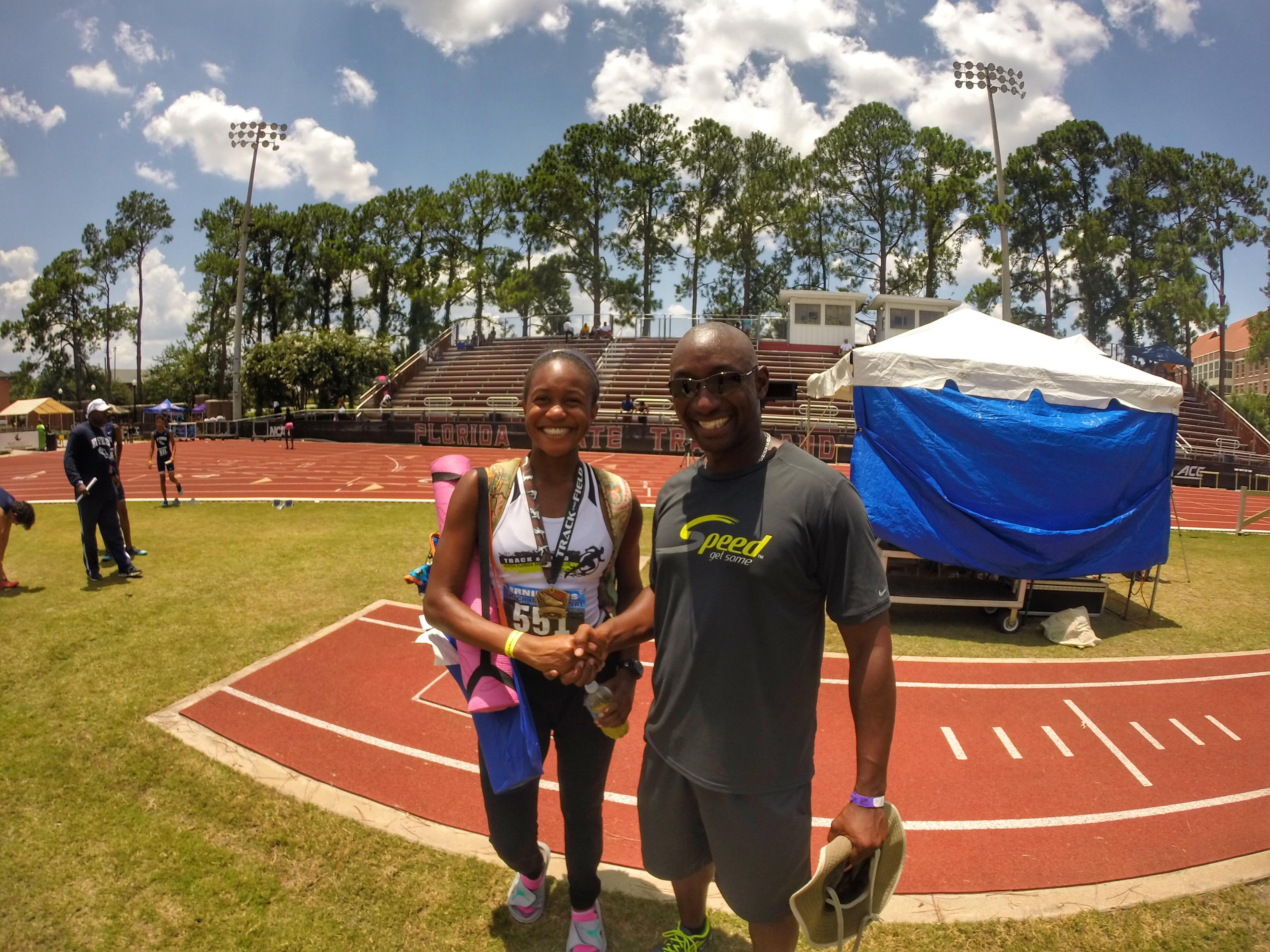 Chiles runner Jianni McDole and North Florida Speed track coach Corey Poole celebrate McDole's personal best in the 800-meter run at the Ernie Sims Track & Field Invitational.