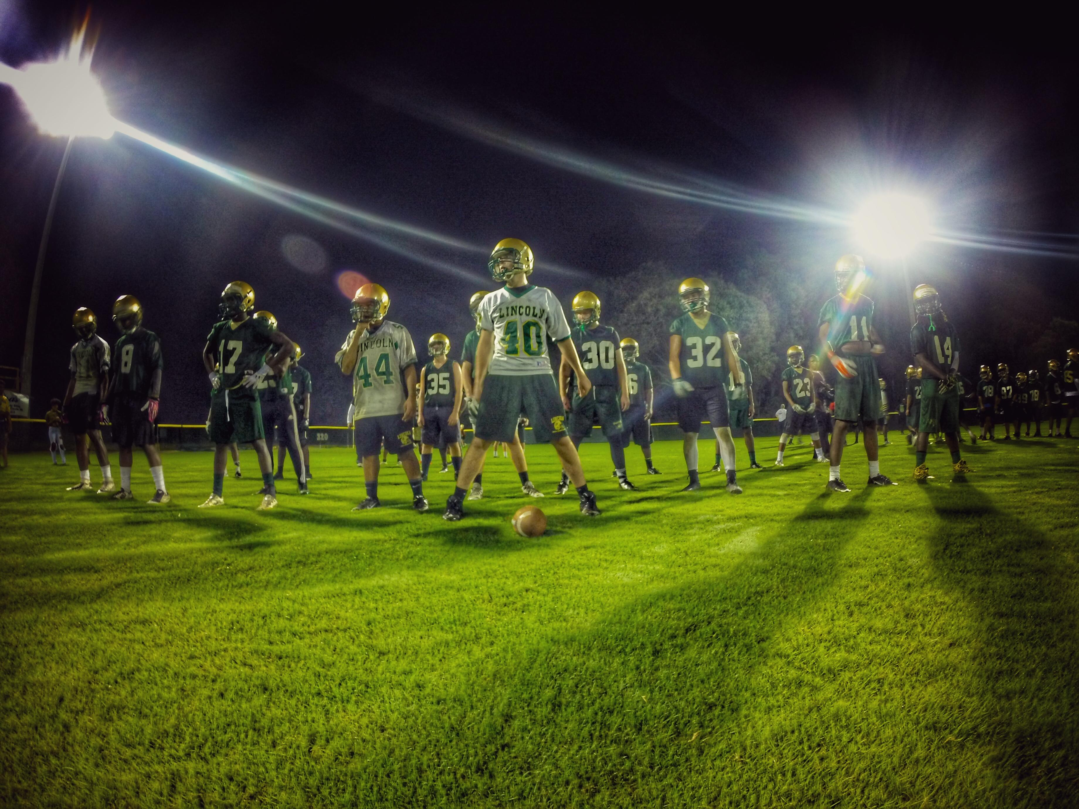 Lincoln's special teams unit lines up in formation during drills for the Trojans' 24th annual Midnight Madness practice.