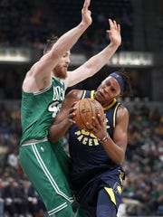Indiana Pacers center Myles Turner (33) drives into Boston Celtics center Aron Baynes (46) in the second half of their game at Bankers Life Fieldhouse Tuesday, December 18, 2017. The Boston Celtics defeated the Indiana Pacers 112-111.