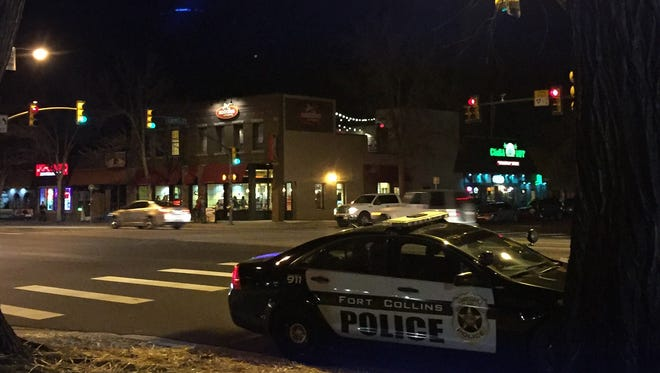 Police investigated a reported hit-and-run crash Friday, Nov. 13, 2015 near the intersection of College Avenue and Laurel Street in Fort Collins.