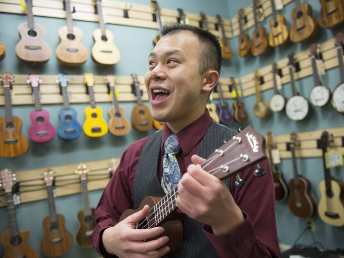 """Samson Trinh teaches his """"Uke 'n' Roll"""" ukulele class at Fan Guitar and Ukulele in Richmond, Va., on Jan. 19. Trinh, an elementary school music teacher by day and performer/bandleader by night, introduced a program that puts ukuleles in the hands of the kids in music classes."""