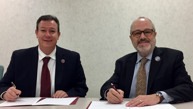 County College of Morris President Anthony Iacono and Centenary University President David Haney sign a Path to Transfer agreement.