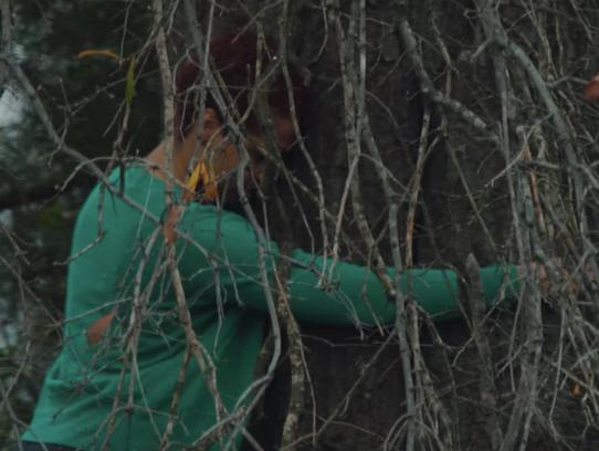 Shirah Dedman hugs the tree where her great-grandfather,