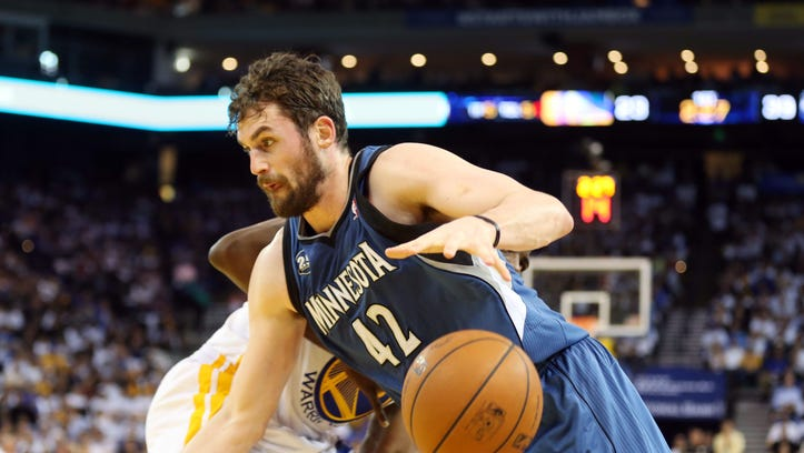 Apr 14, 2014; Oakland, CA, USA; Minnesota Timberwolves forward Kevin Love (42) loses the ball against Golden State Warriors forward Draymond Green (23) during the first quarter at Oracle Arena. Mandatory Credit: Kelley L Cox-USA TODAY Sports