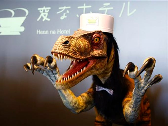 A receptionist dinosaur robot performs at the new robot