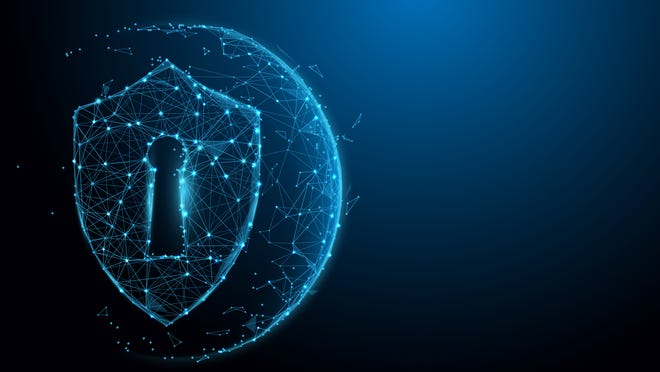 A cyber-security graphic, in the shape of a shield around a keyhole.