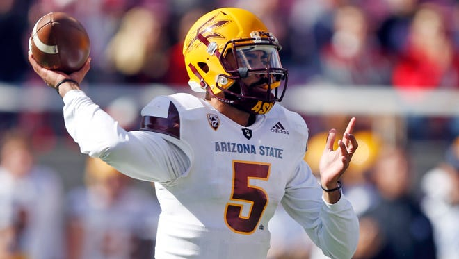 Arizona State quarterback Manny Wilkins (5) passes the ball against Utah in the first half of an NCAA college football game, Saturday, Oct. 21, 2017, in Salt Lake City. (AP Photo/Rick Bowmer)