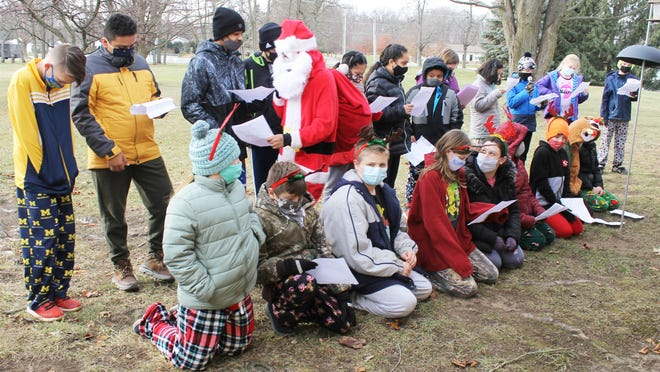 """Students at St. Mary's Assumption School sang carols outside Thurston Woods Village in Sturgis and told the story """"The Night Before Christmas."""""""