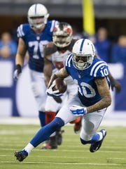 Indianapolis Colts wide receiver Donte Moncrief (10) brings the ball upfield after a reception against the Tampa Bay Buccaneers.