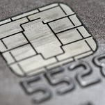 This June 10 photo shows a chip credit card in Philadelphia. Even as an Oct.1 deadline approaches to switch Americans over to credit cards embedded with chips, the vast majority still does not have the new cards and only some are using them as intended, a new Associated Press-GfK poll shows.