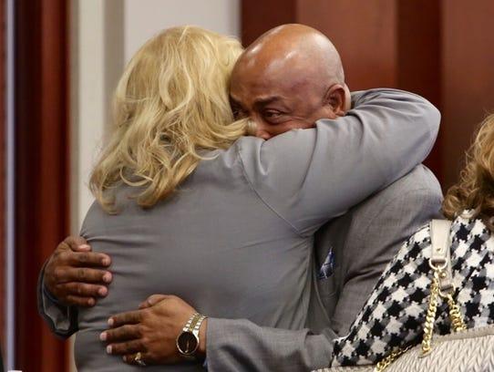 Virgil hugs Linda Smith of Kentucky Innocence Project.