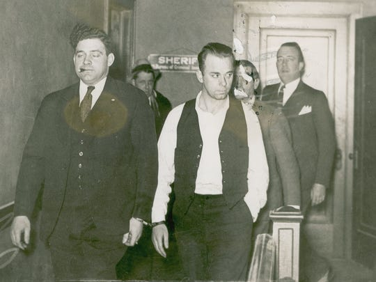 John Dillinger (right) is marched into a Crown Point, Ind., courtroom on Jan. 31, 1934, for his arraignment on murder charges.