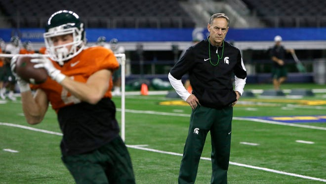 Michigan State head coach Mark Dantonio, right, watches his team practice for the Cotton Bowl NCAA college football game against Alabama, Monday, Dec. 28, 2015, in Arlington, Texas.
