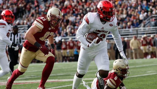 Nov 5, 2016; Boston, MA, USA; Louisville Cardinals line backer Stacy Thomas (32) recovers a fumble while pursued by Boston College Eagles wide receiver Charlie Callinan (83) during the first quarter at Boston College  at Alumni Stadium. Mandatory Credit: Greg M. Cooper-USA TODAY Sports