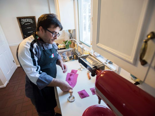 Chef Salvatore Arru cuts out different shapes of his pasta Sunday, Jan. 16, at his home in St. Clair.