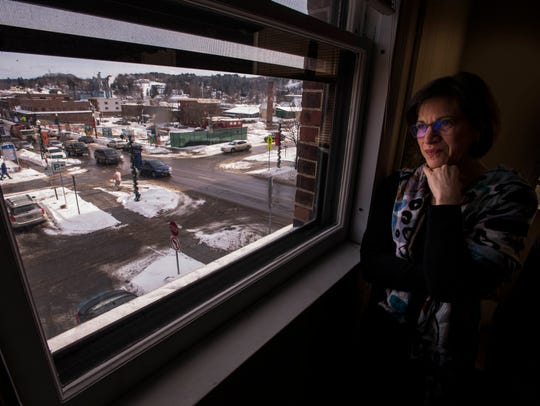 Laura Dolgin, Newport's city manager in February 2017, looks down from the top floor of City Hall at the infamous hole on Main Street left when Jay Peak owner Ariel Quiros' grand plans for the town collapsed under the weight of federal and state fraud accusations.