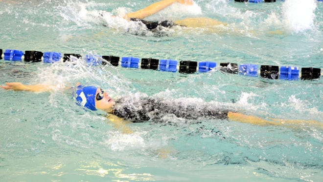 Carlsbad's Isabella Corder swims the 100-meter backstroke during the Eagle Invitational Saturday at Hobbs. Corder came in third place at 1:13.26.