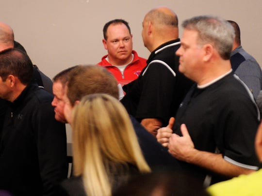 Cooper head football coach Todd Moebes talks with a coach during the UIL Realignment meeting on Thursday, Feb. 1, 2018 at the Birdville ISD Fine Arts and Athletics Complex.