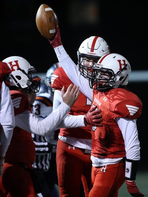Christian Julian celebrates his interception late in the fourth quarter that sealed Hingham's 14-8 playoff win over Walpole.