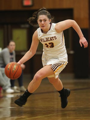 Weymouth High player Kerin McCarthy dribbles towards the basket during a Bay State Conference game in February.  averaging just under 19 points per game this season for the Wildcats.