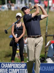 Jim Furyk watches his shot in the long drive competition