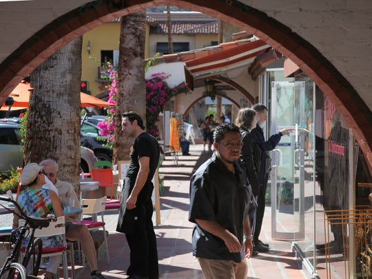 Shoppers in downtown Palm Springs are seen in this Desert Sun file photo.