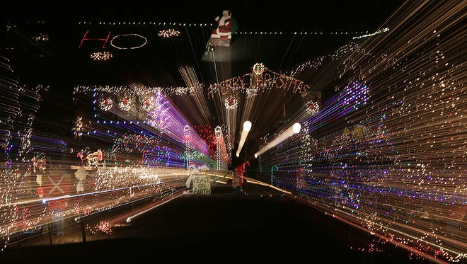 Aaron Wood's Christmas lights display is seen at his home in Darden, Tenn., on Thursday, Dec. 15, 2016.