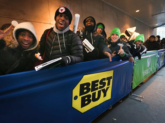 Fans cheer while in line at the Best Buy Theater, where they anxiously await the chance to purchase the first Xbox One console at midnight.