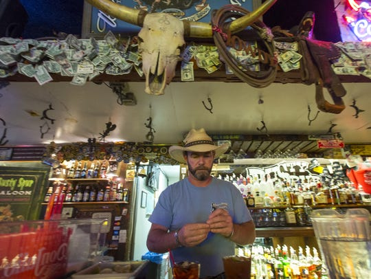Tim Colvert mixes drinks at the Rusty Spur Saloon in