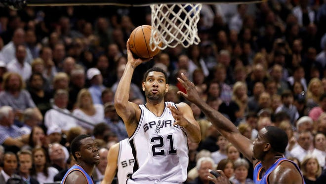 San Antonio's Tim Duncan, center, shoots against Oklahoma City in Game 2 of the Western Conference finals on Wednesday.