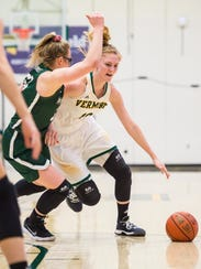 The University of Vermont's Hanna Crymble drives on