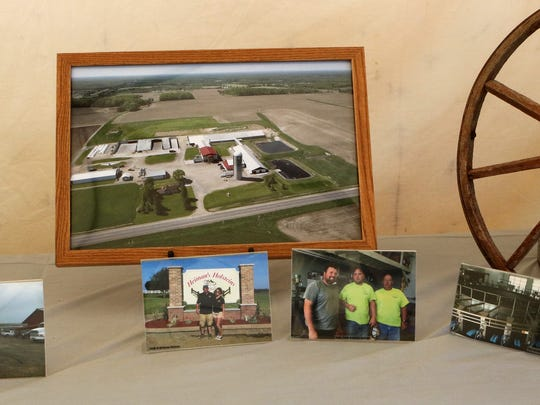 A display at the 2017 Farm Technology Days showed pictures of the families hosting the 2018 event. Pictured are images from the Heiman families.