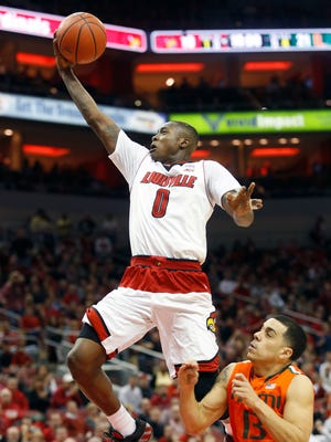Louisville's Terry Rozier drives for a layup against Miami in February. Rozier is trying this week to impress scouts at the NBA Draft Combine.