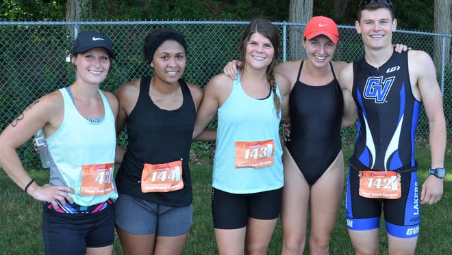 Overall Cereal City Triathlon champ Brandon VanOosten, right, celebrates his win with his family, including, from left, sister Kristin Donaldson, sister-in-law, Megan VanOosten, sister Caitlin VanOosten and girlfriend Maggie Wood.