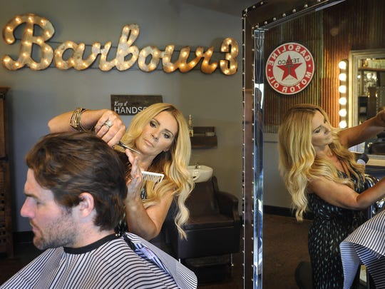 Hair stylist to the stars Melissa Schleicher styles Predators player Mike Fisher's hair at Barbour 3 in Brentwood on June 5.