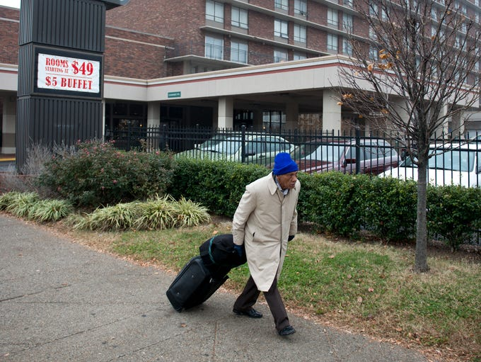 Charles Smith pulled his belongings along the sidewalk on Broadway in front of Wayside Christian Mission's Hotel Louisville.  After a rocky start the local institution is thriving as a combination hotel, shelter for the homeless and addiction recovery program.  Dec 3, 2013