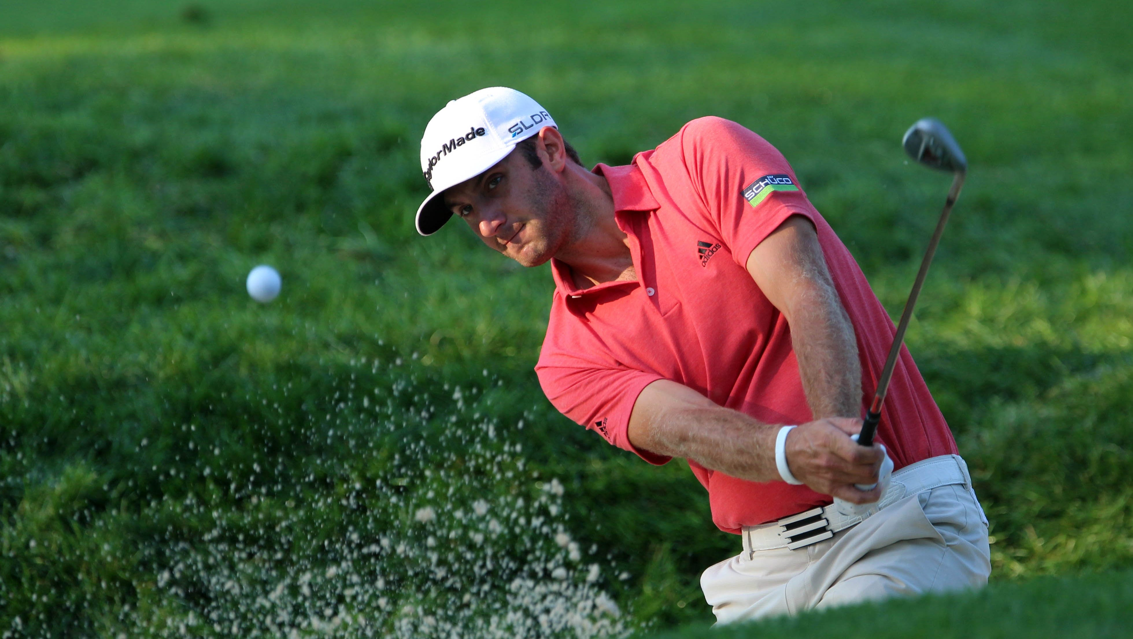 Dustin Johnson warms up before the first round of the 95th PGA Championship at Oak Hill Country Club.