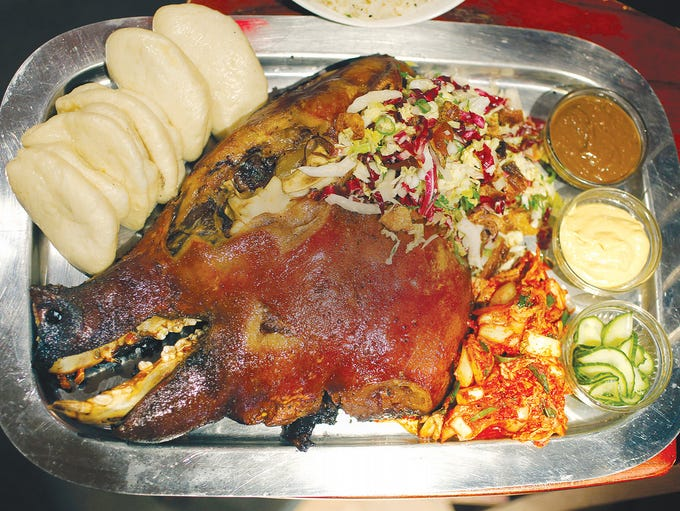 Half roasted pig head at ButaPub.