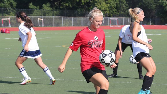 Somers High School girls soccer co-captain Melina Couzis practices with the team on Friday.