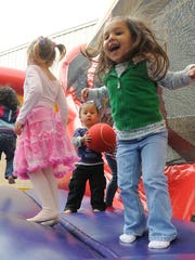 Kids can enjoy a bouncy house at the YMCA Summer Wrap Up and Back to School Party on Saturday.