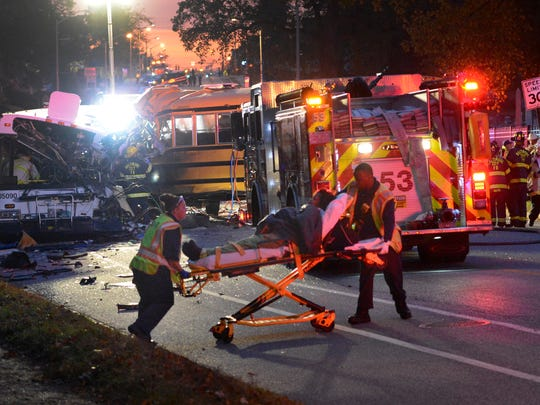 Fire department and rescue officials are at the scene of an early morning fatal collision between a school bus and a commuter bus Tuesday, Nov. 1, 2016, in Baltimore.