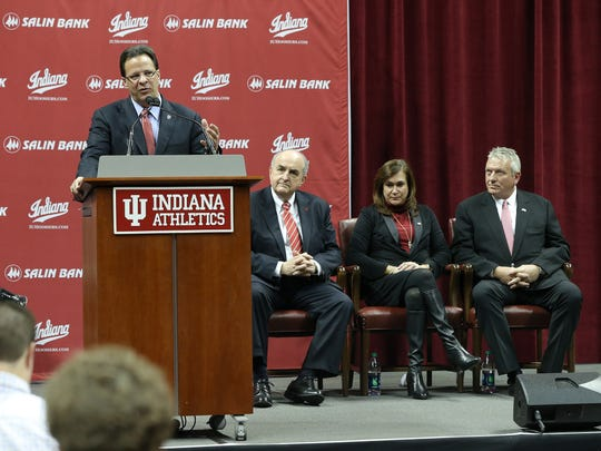 IU men's basketball coach Tom Crean delivers his address as IU President Michale McRobbie,sitting, Cindy Simon Skjodt,middle, and Paul Skjodt,right, listen during the announcement her gift of $40 Million for the needed renovations to Indiana University's Assembly Hall in Bloomington.