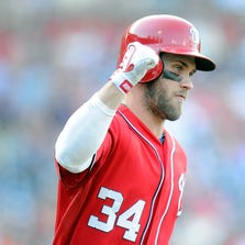 WASHINGTON, DC - AUGUST 24:  Bryce Harper #34 of the Washington Nationals celebrates after hitting a home run in the eighth inning against the San Francisco Giants at Nationals Park on August 24, 2014 in Washington, DC. Washington won the game 14-6.